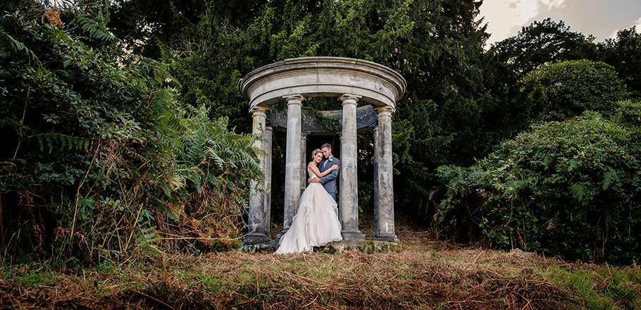 outdoor wedding temple with bride and groom