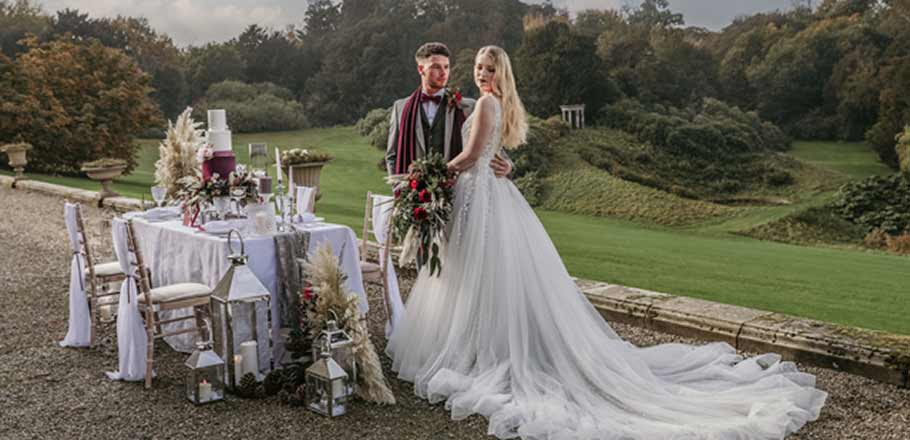 bride, groom and table at their outdoor wedding at Birdsall