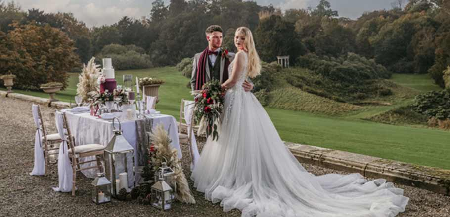 bride, groom and table outdoors at Birdsall Estate