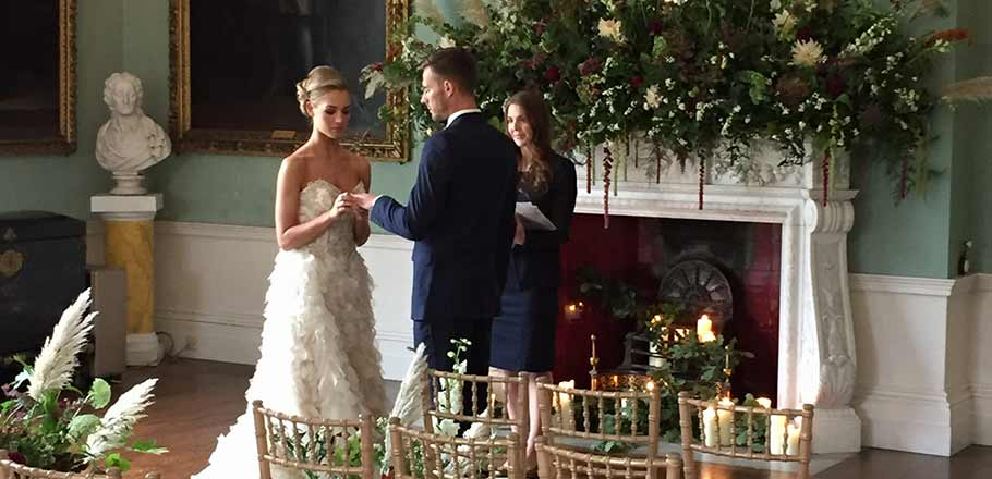 bride and groom exchanging rings at a Birdsall wedding ceremony