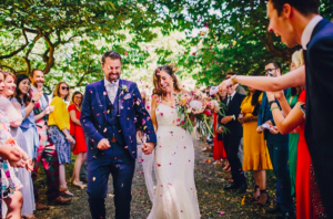 bridal couple being showered with confetti