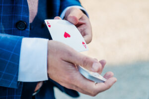 magician holding ace of hearts card