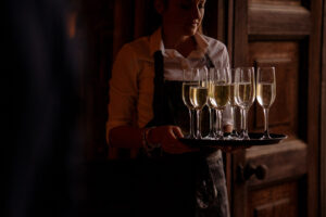 woman holding a tray of champagne